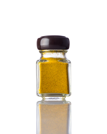 curry powder: Jar of Yellow curry powder spice isolated on white background