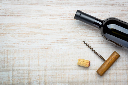 cork screw: Bottle dark red wine with cork and cork screw with copy space Stock Photo