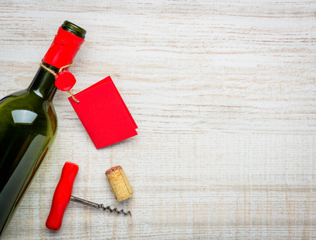 cork screw: Opened wine bottle and red label with cork screw and copy space Stock Photo