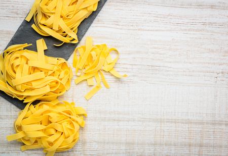 fettuccine: Yellow Fettuccine Pasta Food with Copy Space Stock Photo