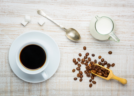 White cup of Coffe with Milk, sugar and coffee beans Stock Photo - 54097354