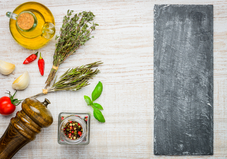 vegtables: Black board copy space with herbs, spices, seasoning and vegtables cooking ingredients Stock Photo