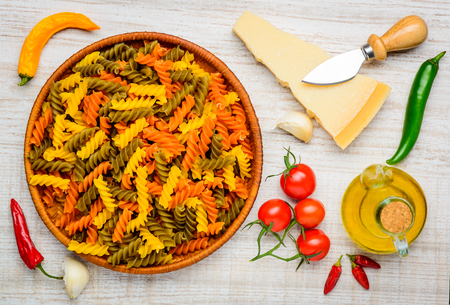 vegtables: Colored Fusilli Doppia Rigatura with Parmigiano Reggiano Parmesan cheese and cooking Ingredients