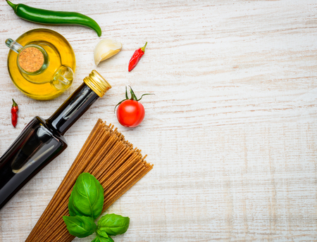 vegtables: Cooking ingredients, olive oil, balsamic vinegar and Italian cuisine Brown Spaghetti pasta with copy space
