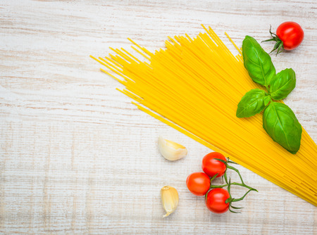 vegtables: Yellow Spaghetti pasta with cooking ingredients, vegtables and copy space Stock Photo