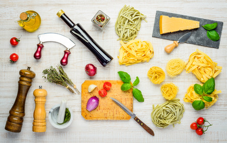 mediterranean cuisine: Mediterranean Cuisine Food with Tagliatelle and Tagliolini and Parmigiano Reggiano Parmesan Cheese and Seasonings Stock Photo