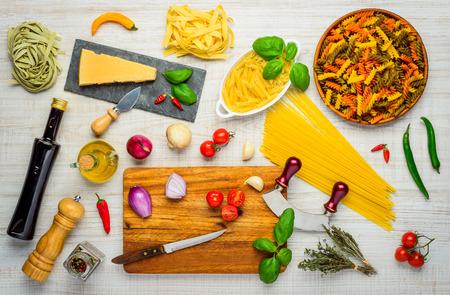 mediterranean food: Mediterranean Food with Pasta, olive Oil, Seasonings and Cooking Herbs Stock Photo