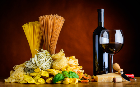 redwine: Italian Food cuisine with Red Wine and Different Types of Pasta. Stock Photo
