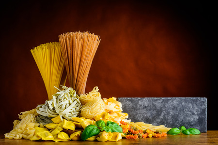 Italian Pasta with copy space. Italian cuisine food with Spaghetti, tagliatelle, tortelini and fusilli doppia rigatura