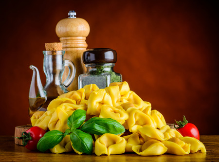 seasonings: Yellow Italian Tortellini Pasta with Food Seasonings and Spices