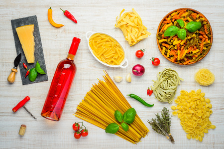 rose wine: Bottle of rose Wine with Italian Pasta and Parmesan cheese and cooking ingredients