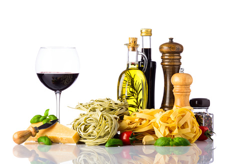 Italian or mediterranean cuisine food with Red Wine, parmigiano-reggiano parmesan cheese and tagliatelle pasta and cooking ingredients.