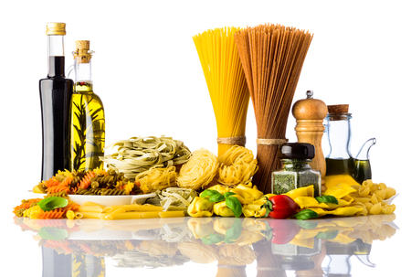 mediterranean cuisine: Different types of pasta and cooking ingredients isolated on white background, Italian and Mediterranean cuisine food.