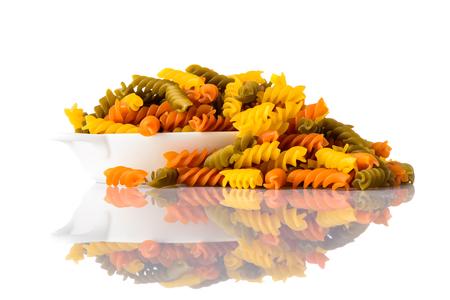 fusilli: Green, red and yellow colored Fusilli Doppia Rigatura Pasta. Italian food, mediterranean cuisine