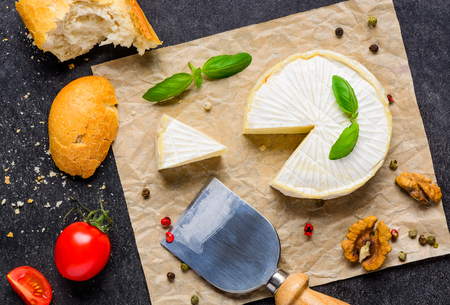 cheese knife: Camembert Soft Cheese with Bread, Nuts and Tomato and Cheese Knife Stock Photo