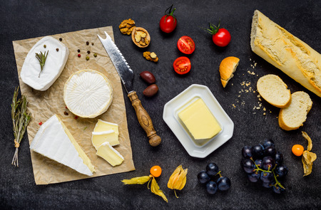 french cuisine: French Cuisine Food with Brie and Camembert Cheese, Fruits and French Bread