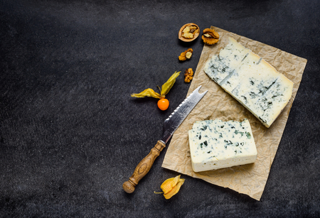 gorgonzola: Blue Mold Gorgonzola Cheese with nuts and Poha fruits on Copy Space
