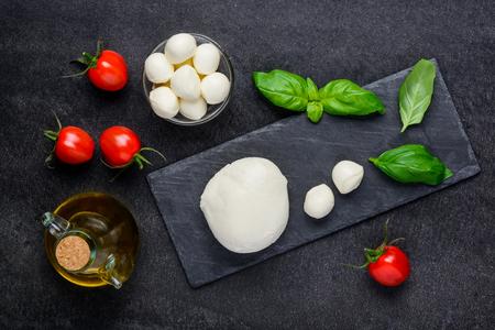 Italian cuisine mozzarella cheese with fresh tomato and basil Stock Photo