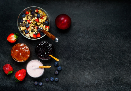 eating area: Breakfast Food with Yogurt, Jam and fresh fruits on Copy Space Stock Photo