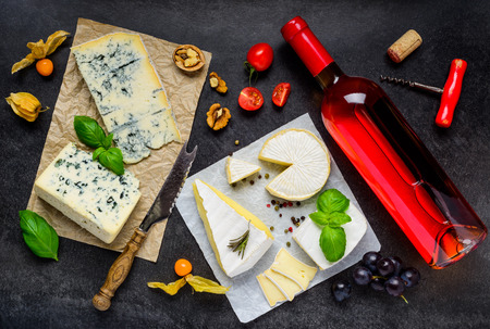 roquefort: Mold Blue Roquefort Cheese, Bire Cheese and Bottle of Rose Wine and fruits Stock Photo
