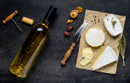 french cuisine: Bottle of White Wine with Camembert and brie soft French Cheese. French Cuisine