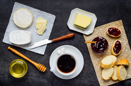 bread and butter: Hot Coffee with Breakfast food. Cheese with Bread, Butter and jam on dark Table