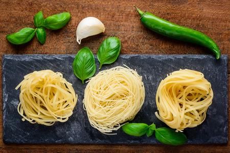 fettuccine: Green Herbs and Vegetables with tagliatelle tagliolini fettuccine pasta Stock Photo