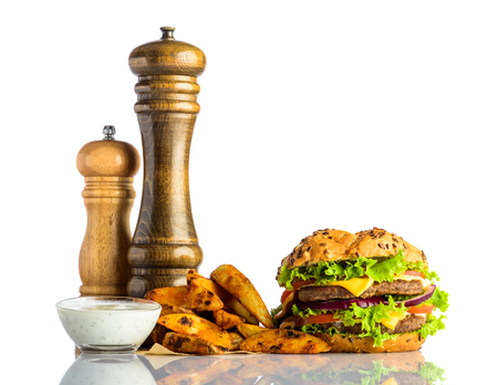 fried potatoes: Fast Food Burger Sandwich with Fried Potatoes and white dipping souce on white background Stock Photo