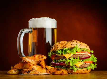 fried potatoes: Fast food with Cold beer, Burger and crunchy Fried Potatoes