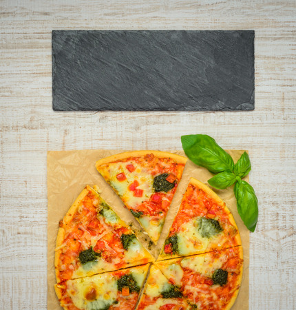 space   area: Traditional Italian Pizza sliced and Baked with Dark Plate as Copy Space Area