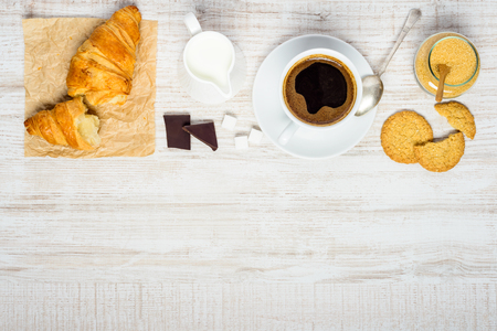 space   area: Black Coffee Drink in Coffee Cup with Croissant, biscuit and Chocolate on Copy Space Area Stock Photo