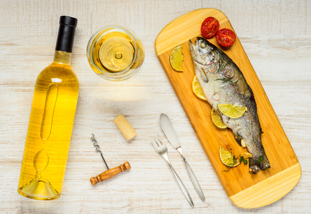 cork screw: Glass and Bottle of White Wine with Cooked Trout Fish and Cork with Cork Screw