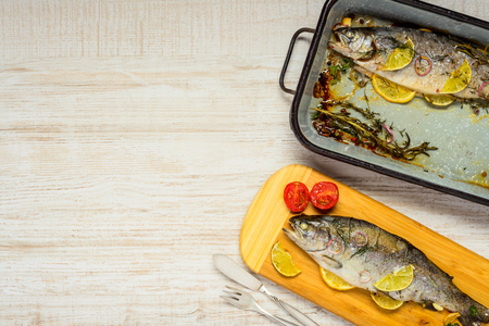 eating area: Baked Trout Fish with Square Pan and Copy Space Area Stock Photo