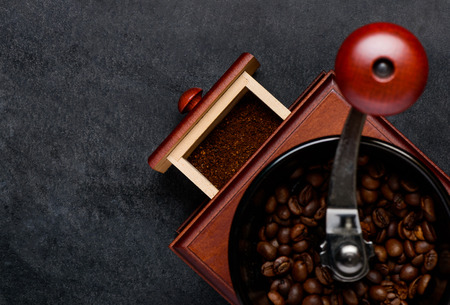 space   area: Wooden Coffee Grinder with brown coffee beans and Copy Space Area