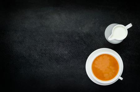 space   area: Black Tea with Milk with Teacup and Copy Space Area