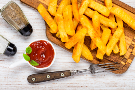 condiments: French Fried Potatoes with Ketchup and Condiments