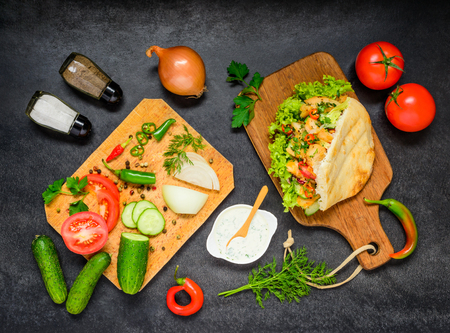doner: Fresh Vegetables with Turkish Doner Kebab Sandwich and Condiments Stock Photo