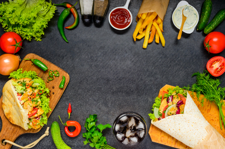 Doner Kebab Sandwich, Shawarma and Fresh Organic Vegetables on a Copy Space Frame Stock Photo - 64760722
