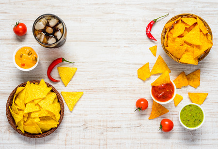 space text: Tortilla Chips with Cold Cola and Ice on Copy Space Text area and in Top view Stock Photo