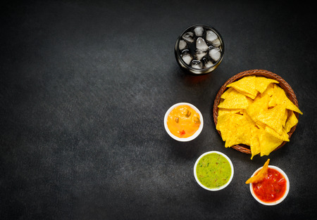 space text: Copy Space Text Area with Nacho Chips, Cold Cola and Dip in Top View Stock Photo
