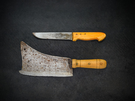 cleaver: Top View of Butcher Knife and Meat Cleaver on Dark Background