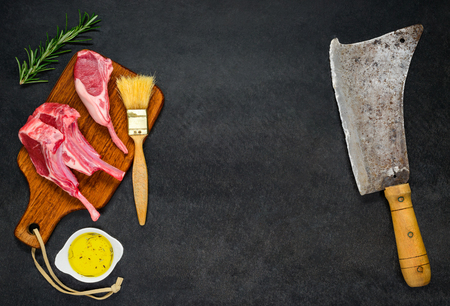 cleaver: Copy Space Text Area of Raw Meat Chops with Meat Cleaver in Top View Stock Photo