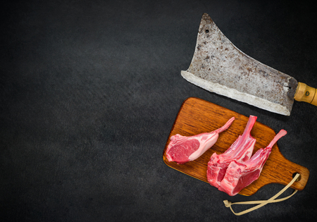 cleaver: Top View of Meat Cleaver with Raw Lamb Ribs and Copy Space Area