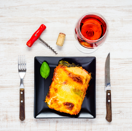 rose wine: Top View of Baked Lasagna Pasta with Glass of Rose Wine