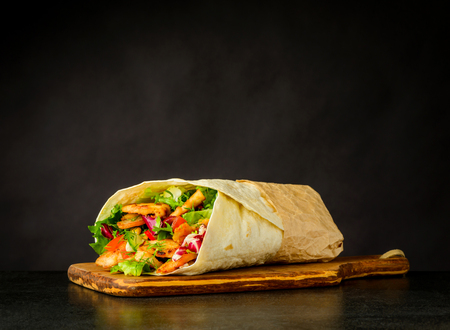 Shawarma Turkish Sandwich with Meat and Vegetables on Dark Background Stockfoto