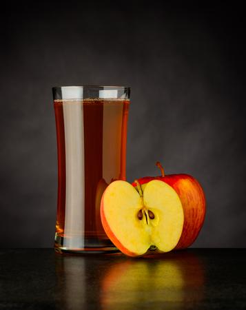 Glass of Organic Sliced Apple Juice on Dark Background