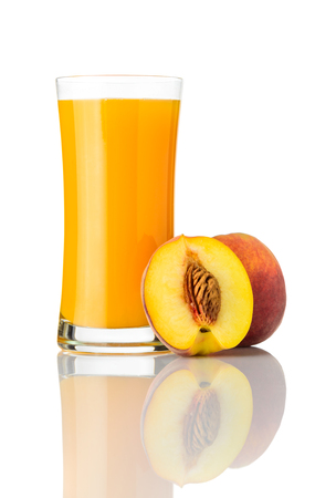Fresh and Organic Peach Juice Drink in Glass isolated on White Background