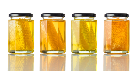 Different Types of Honey with Honeycomb and Isolated on White Background Stock Photo - 76482457
