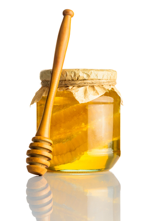 Honey Jar with Wooden Honeydipper on White Background