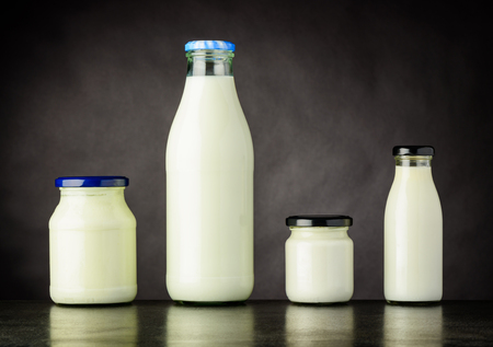 Different Types of Milka and Dairy Products in Bottle and Jar on Dark Background Stock Photo - 77819819